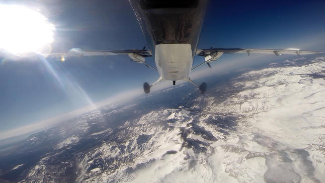 In this frame grab from video, scientists from NASA's Jet Propulsion Laboratory fly over the Tuolumne River Basin of California's Sierra Nevada mountain range in a de Havilland Twin Otter plane to measure the snowpack on Sunday, March 23, 2014. The new Airborne Snow Observatory measures the snowpack's depth and water content with precision amid California's drought.